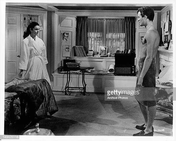 Sharon Hugueny and Peter Fonda in bathrobe and towel in a scene from the film 'The Young Lovers' 1964