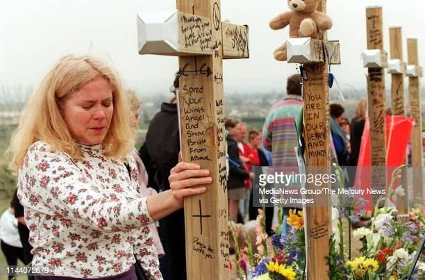 APRIL 28 1999 LITTLETON CO Sharon Jansen of Denver visits the hilltop memorial above Columbine High School in Littleton Colo on April 28 1999