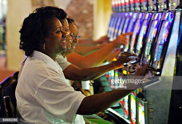 Sharon Johnson foreground her sister Andrea Bryant center and their friend Carol Peters play video gaming machines inside Harrah's New Orleans casino...