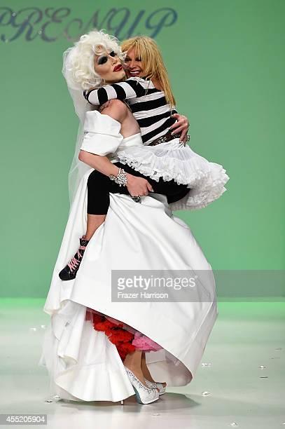 Sharon Needles and designer Betsey Johnson walk the runway at the Betsey Johnson fashion show during MercedesBenz Fashion Week Spring 2015 at The...