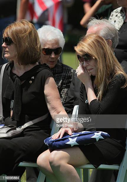 Sharon Olivieri is comforted by her motherinlaw Jodi Olivieri at the graveside service for her husband US Army PFC Michael Olivieri of Homer Glen...