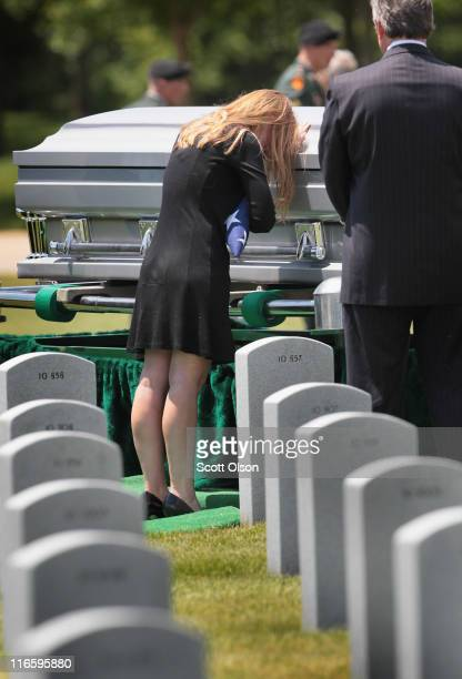 Sharon Olivieri says goodbye to her husband US Army PFC Michael Olivieri of Homer Glen Illinois following a service at Abraham Lincoln National...