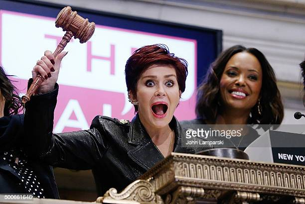 Sharon Osbourne and Aisha Tyler of CBS' The Talk ring the closing bell at the New York Stock Exchange on December 9 2015 in New York City