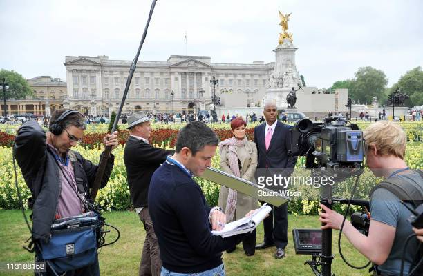 Sharon Osbourne and Kevin Frazier appear in front of Buckingham Palace in London for 'The Insider's' coverage of the Royal Wedding at Buckingham...