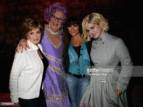 Sharon Osbourne Dame Edna Everedge Natasha Hamilton and Kelly Osbourne pose backstage during The Prince's Trust 30th Live concert held at the Tower...
