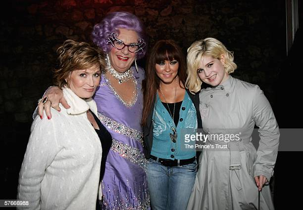 Sharon Osbourne Dame Edna Everedge Natasha Hamilton of Atomic Kitten and Kelly Osbourne pose backstage during The Prince's Trust 30th Live concert...