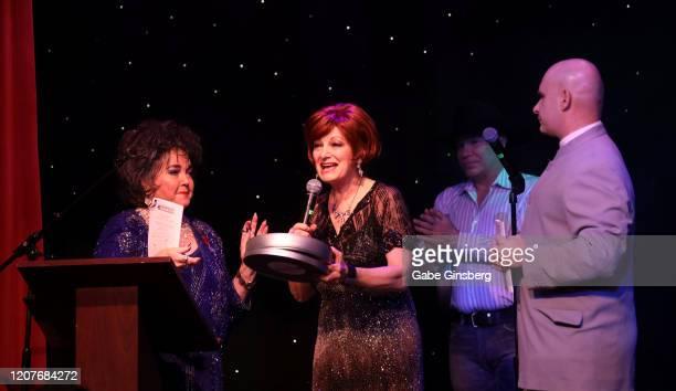 Sharon Osbourne impersonator Caroline Bernstein of the United Kingdom accepts the Comedy award as Elizabeth Taylor impersonator Louise Gallagher...
