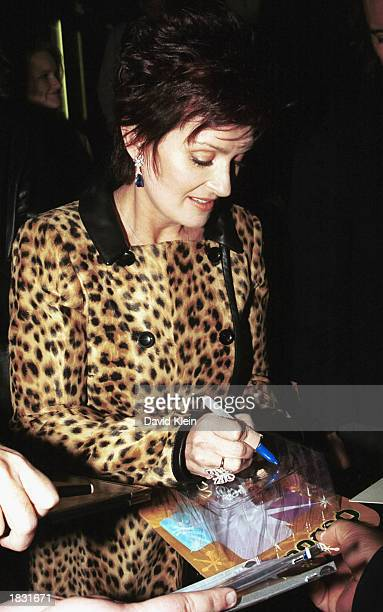Sharon Osbourne wife of rock star Ozzy Osbourne signs autogrphs as she arrives at the CNN studios for an interview on the CNN show Larry King Live on...