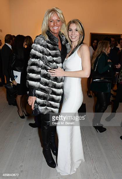 """Sharon Pask and Stasha Palos attend a private view of """"And The Stars Shine Down"""" by Stasha Palos at the Saatchi Gallery on December 2, 2014 in..."""
