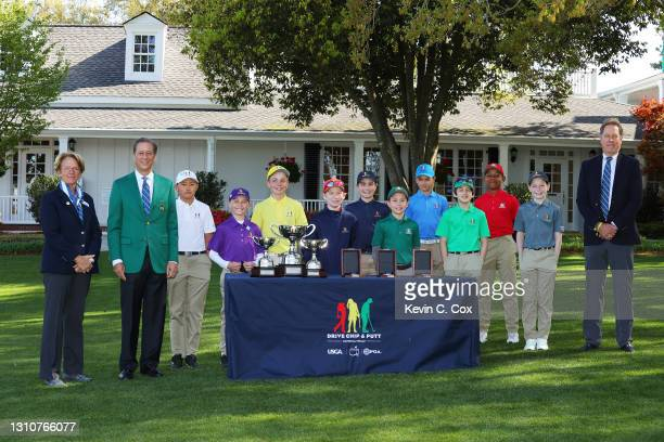Sharon Ritchey of the USGA Executive Committee, Tom Nelson of Augusta National and PGA Vice President John Lindert, pose with participants in the...