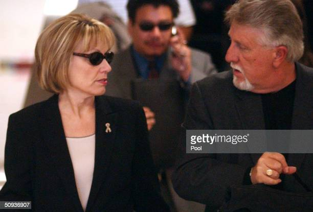 Sharon Rocha mother of Laci Peterson and stepfather Ron Grantski exit the San Mateo County Superior Courthouse June 7 2004 in Redwood City California...