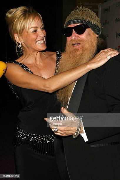 Sharon Stone and Billy Gibbons of ZZ Top during 2006 Clive Davis PreGRAMMY Awards Party Cocktail Reception and Dinner at Beverly Hilton in Beverly...