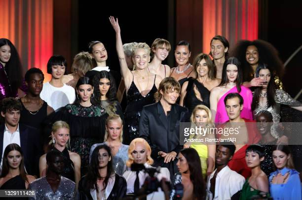 Sharon Stone and Carine Roitfeld on the stage with the models during the amfAR Cannes Gala 2021 at Villa Eilenroc on July 16, 2021 in Cap d'Antibes,...