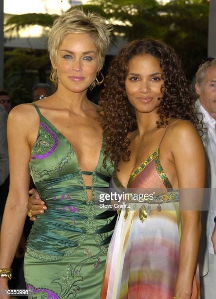 """Sharon Stone and Halle Berry during """"Catwoman"""" World Premiere - Arrivals at Cinerama Dome in Hollywood, California, United States."""