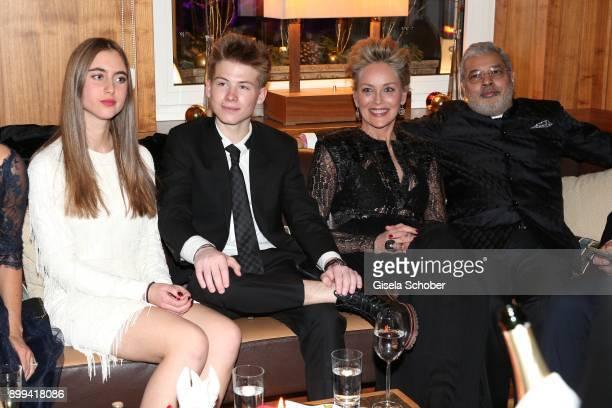 Sharon Stone and her son Roan Joseph Bronstein and Martina Tomasini and her partner Tikka Shatrujit Singh Kapurthala during the charity gala...