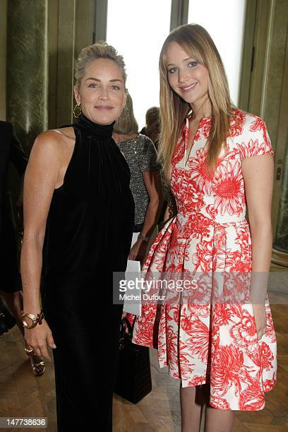 Sharon Stone and Jennifer Lawrence attend the Christian Dior HauteCouture Show as part of Paris Fashion Week Fall / Winter 2013 on July 2 2012 in...