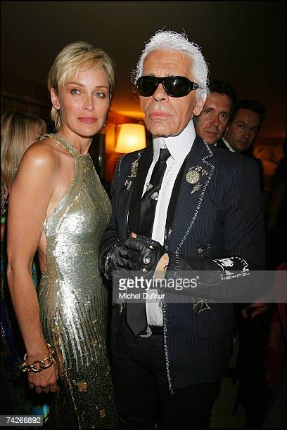 Sharon Stone and Karl Lagerfeld attend a dinner sponsored by magazine Madame Figaro to celebrate the Sixtieth Anniversary of the IFF on May 23 2007...