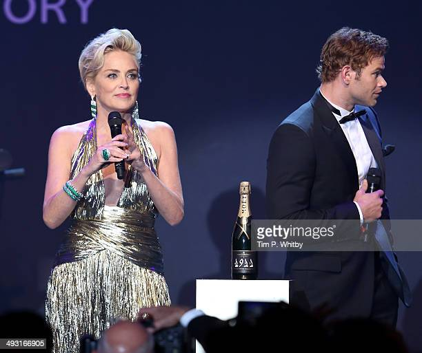 Sharon Stone and Kellan Lutz speak at amfAR's 21st Cinema Against AIDS Gala Presented By WORLDVIEW BOLD FILMS And BVLGARI at Hotel du CapEdenRoc on...