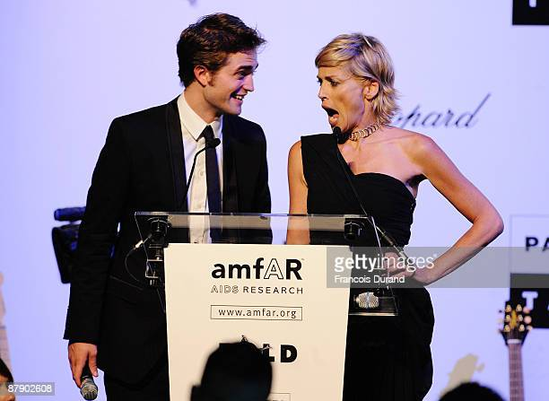 Sharon Stone and Robert Pattinson attend the amfAR Cinema Against AIDS 2009 show at the Hotel du Cap during the 62nd Annual Cannes Film Festival on...