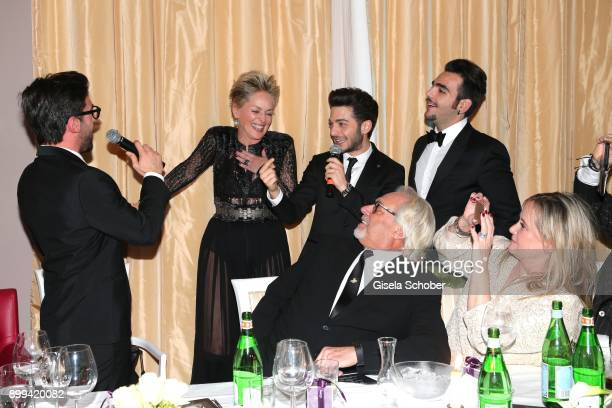 Sharon Stone and singer of Il Volo Piero Barone Gianluca Ginoble and Ignazio Boschetto during the charity gala benefiting 'Planet Hope' foundation at...