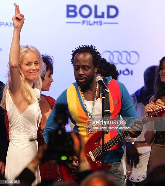 Sharon Stone and Wyclef Jean during amfAR's Cinema Against AIDS Benefit in Cannes, Presented by Bold Films, Palisades Pictures and The Weinstein...