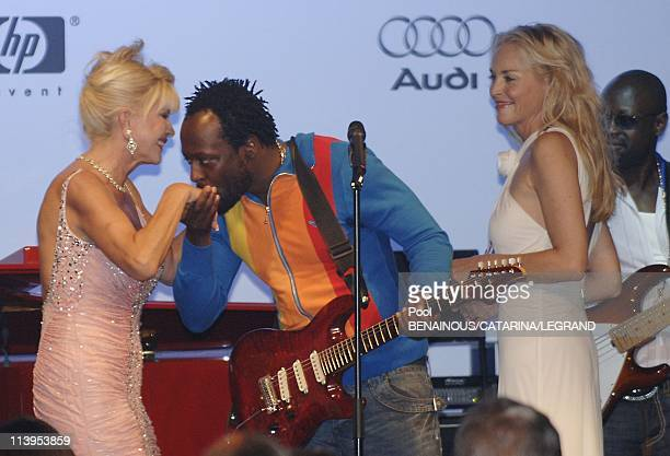 Sharon Stone at AMFAR's auction to raise Funds for AIDS Research Le Moulins de Mougin in Mougins France on May 25 2006Actress Sharon Stone Singer Wy...