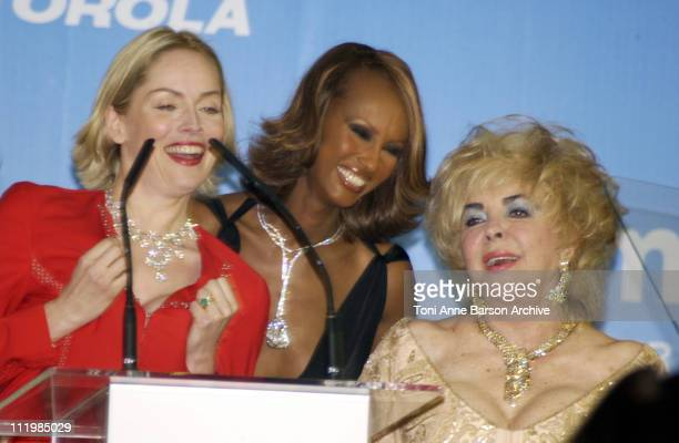 Sharon Stone Iman and Dame Elizabeth Taylor during Cannes 2002 amfAR's Cinema Against AIDS Gala sponsored by Motorola and cosponsored by De Beers...