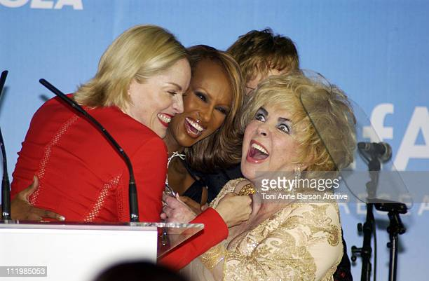 Sharon Stone Iman Dame Elizabeth Taylor during Cannes 2002 amfAR's Cinema Against AIDS Gala sponsored by Motorola and cosponsored by De Beers Auction...