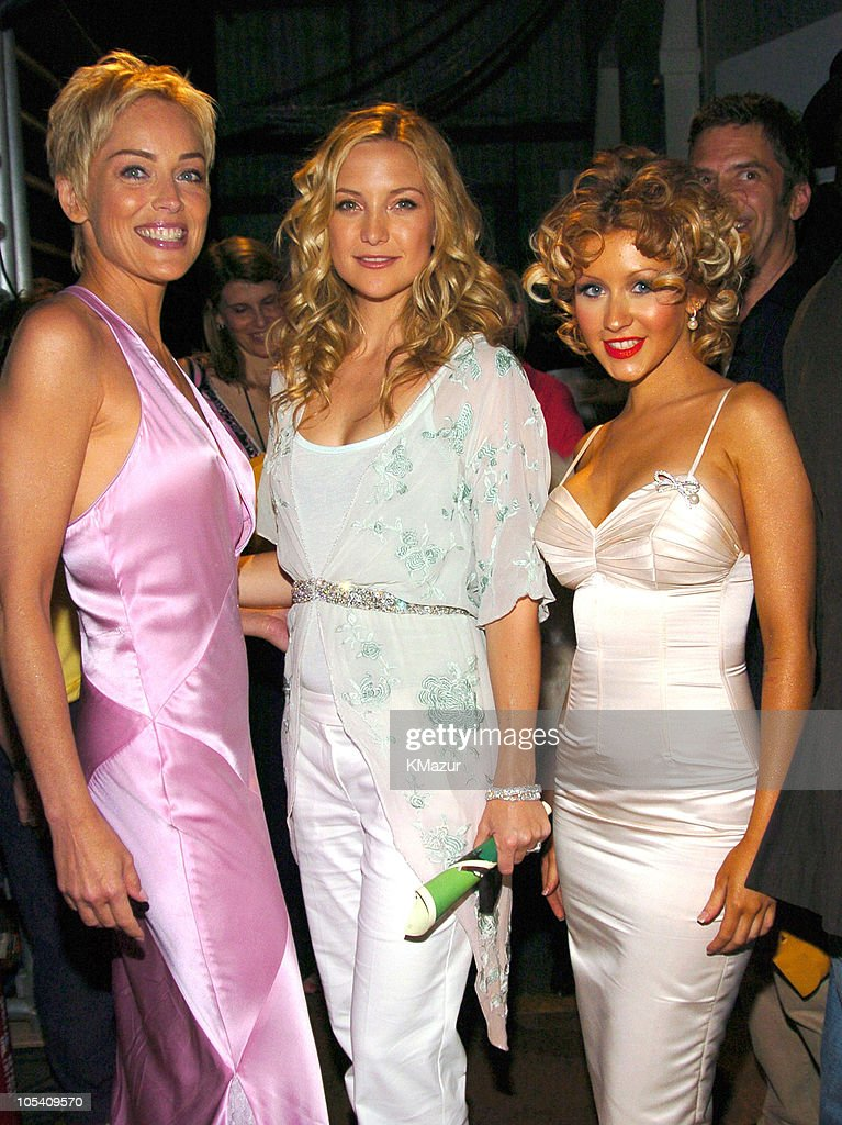 Sharon Stone, Kate Hudson and Christina Aguilera during MTV Movie Awards 2004 - Backstage and Audience at Sony Pictures Studios in Culver City, California, United States.