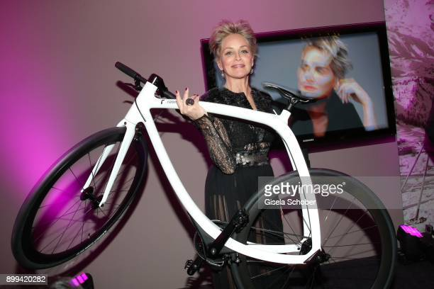 Sharon Stone signs the bicycle during the charity gala benefiting 'Planet Hope' foundation at Kempinski Grand Hotel des Bains on December 28 2017 in...