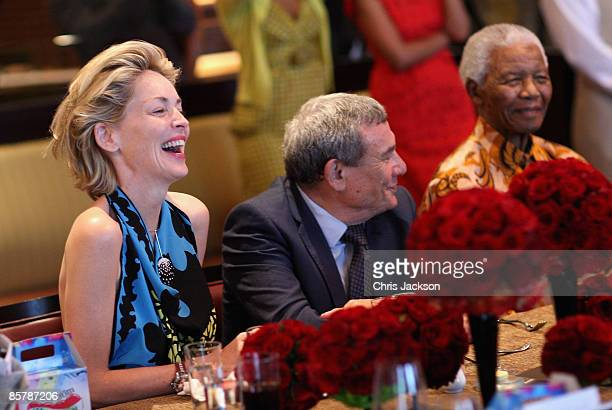 Sharon Stone Sol Kerzner and Nelson Mandela laugh during a lunch to Benefit the Mandela Children's Foundation as part of the celebrations of the...