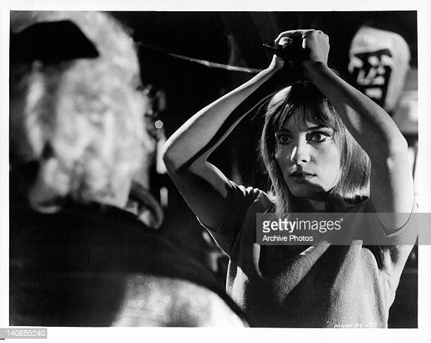 Sharon Tate aiming knife above her head in a scene from the film 'Eye Of The Devil' 1966