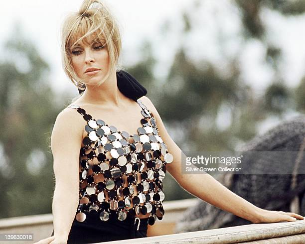 Sharon Tate US actress wearing metallic disc sleeveless top with a scoop neckline in an exterior portrait circa 1965