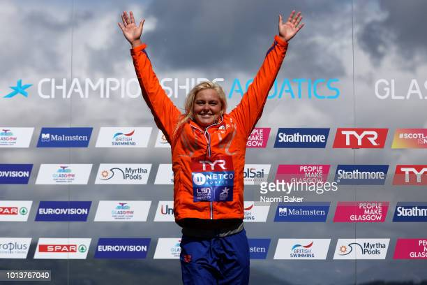 Sharon Van Rouwendaal of the Netherlands celebrates winning the gold medal in the Women's 10km race during the open water swimming on Day eight of...