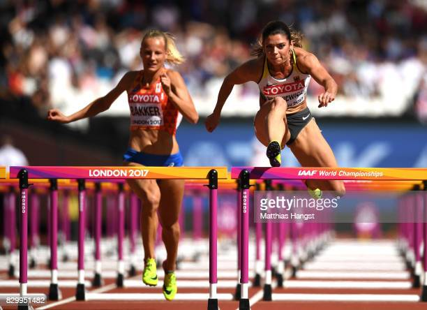 Sharona Bakker of the Netherlands and Pamela Dutkiewicz of Germany compete in the Women's 100 metres hurdles heats during day eight of the 16th IAAF...