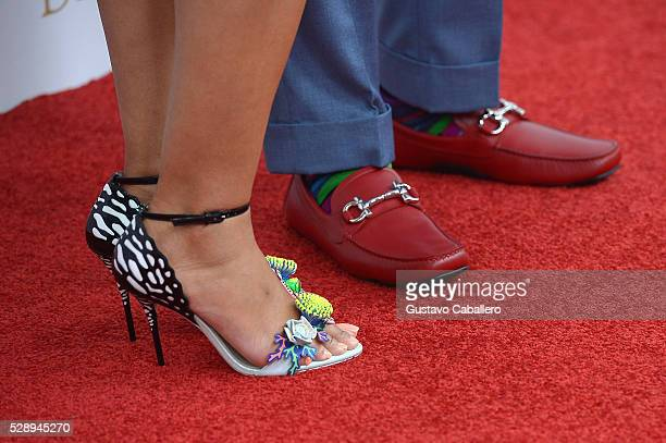 Sharonda Jones and singer Shawn Stockman of Boys II Men shoe detail attend the 142nd Kentucky Derby at Churchill Downs on May 07 2016 in Louisville...