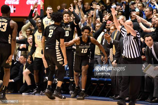 Sharone Wright Jr. #2 of the Wake Forest Demon Deacons reacts with teammates following a three-point basket against the Duke Blue Devils in the...