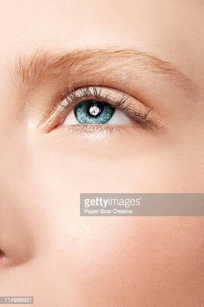 sharp close up of beautiful blue - green eyes