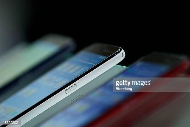 Sharp Corp Aquos Phone Zeta SH01F smartphones for NTT Docomo Inc that feature the indium gallium zinc oxide display sit on display during a media...