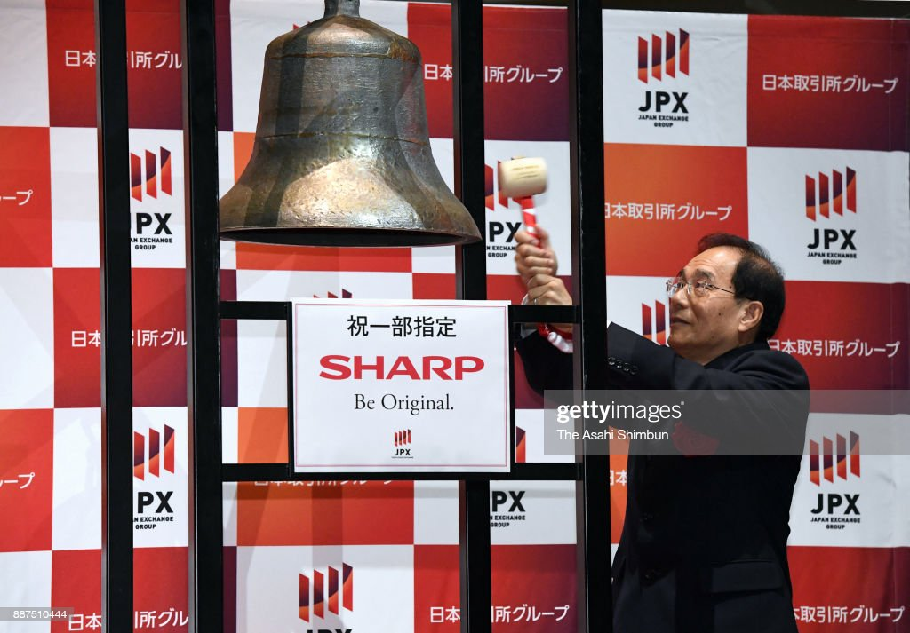 Sharp Corp President Tai Jeng Wu rings the bell during a ceremony at the Tokyo Stock Exchange on December 7, 2017 in Tokyo, Japan. Sharp returns to the first section of the exchange after Taiwanese Hon Hai Precision, as known as Foxconn, acquired in August last year.