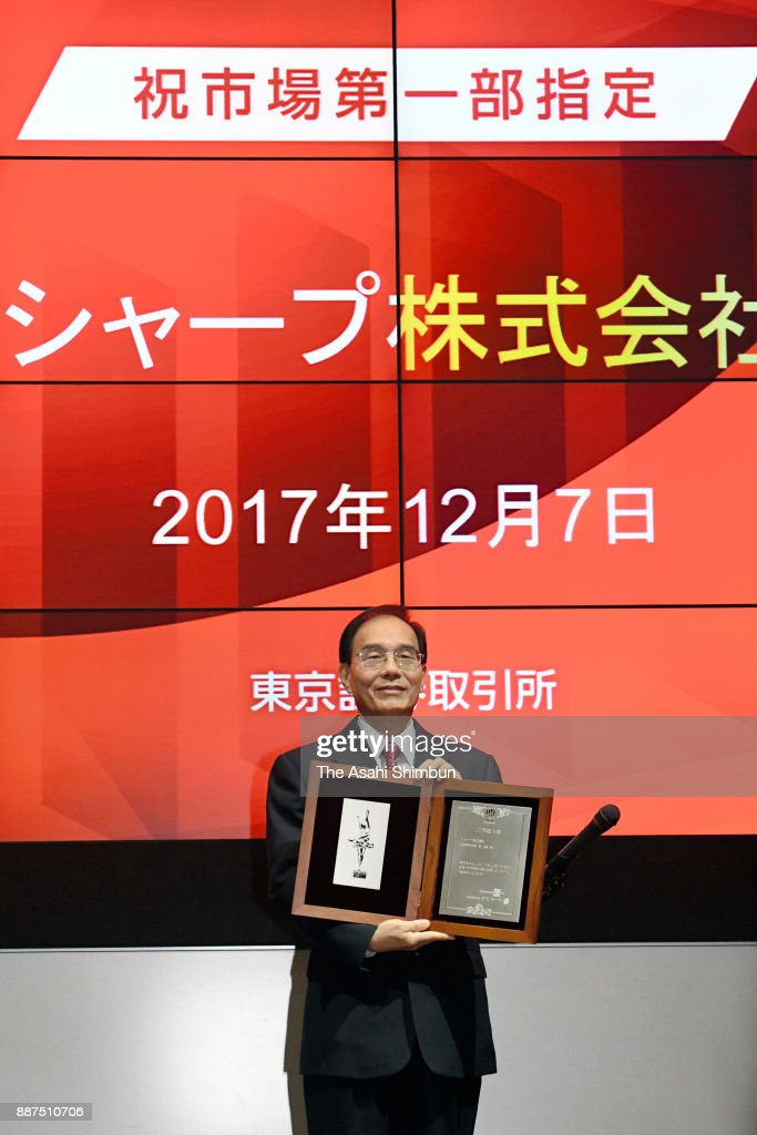Sharp Corp President Tai Jeng Wu shows a certificate during a ceremony at the Tokyo Stock Exchange on December 7, 2017 in Tokyo, Japan. Sharp returns to the first section of the exchange after Taiwanese Hon Hai Precision, as known as Foxconn, acquired in August last year.