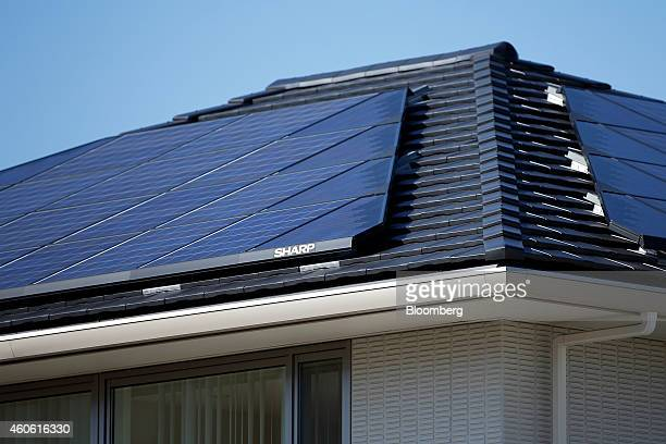Sharp Corp solar panels sit on the rooftops of a model smart home in Toyota Motor Corp's Ecoful Town in the Higashiyama district of Toyota City Aichi...
