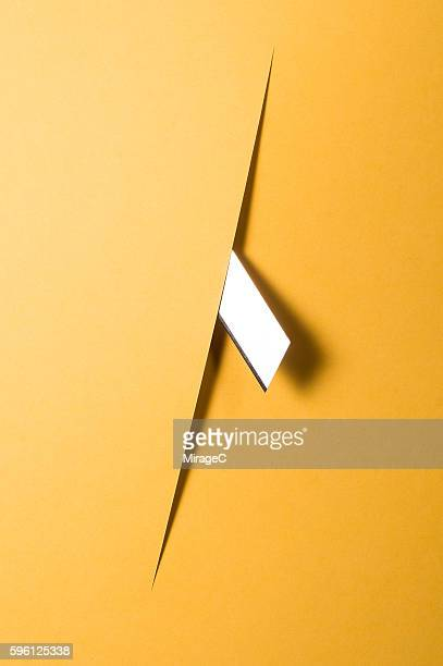 Sharp Knife Cutting Through Construction Paper