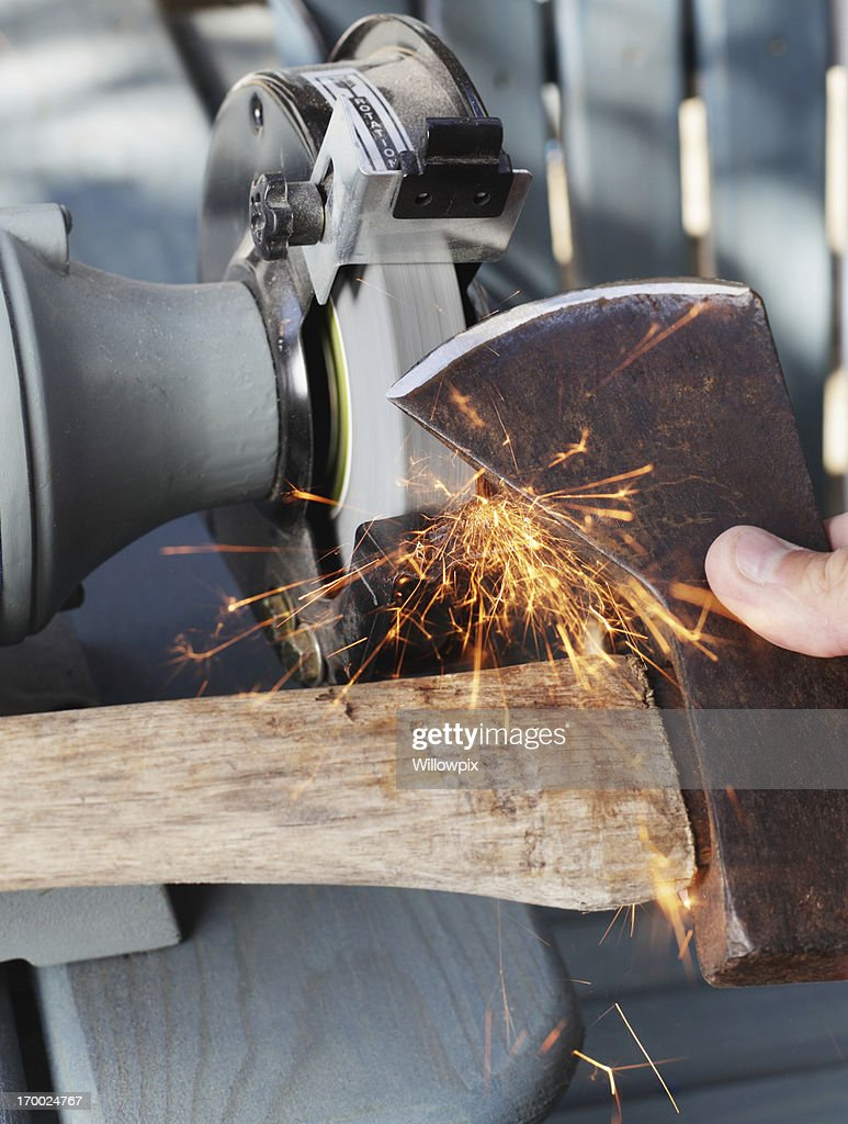 Sharpening an Old Axe : Stock Photo