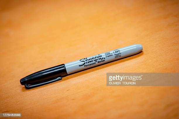 Sharpie brand marker sits on a table in Phoenix, Arizona, on November 5, 2020. - Allegations of fraud and foul play in the 2020 election spread...