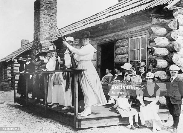 Sharpshooter Annie Oakley teaching women how to shoot
