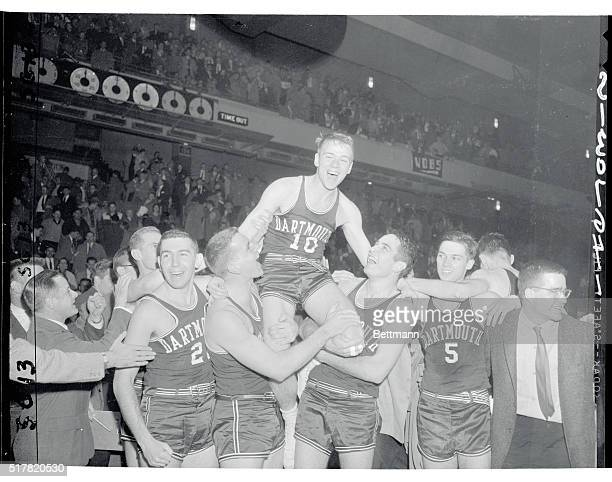 Sharp-shooter Larry Blades of Dartmouth is carried off the court by teammates after sinking a field goal with one second remaining in the game to...