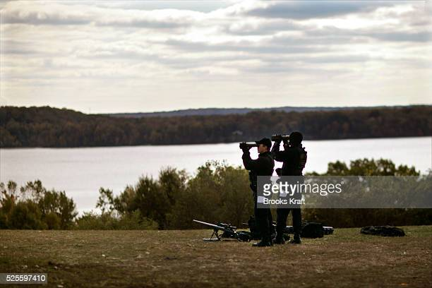 Sharpshooters from the Counter Assualt and Team of the Secret Service patrol the Potomac River as President George W Bush and French President...