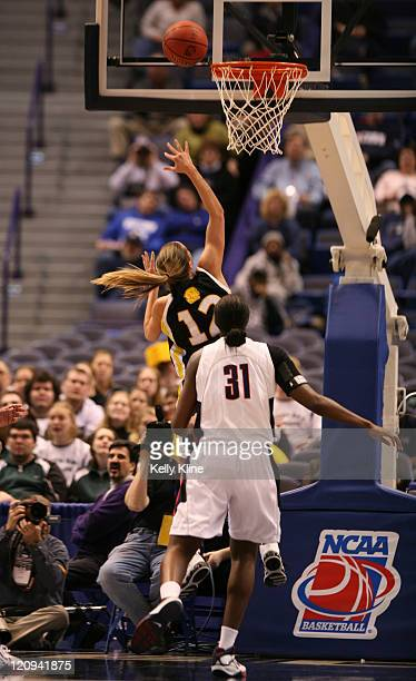 Sharri Rohde of UMBC laying it up against Tina Charles and the UConn Huskies in the firsthalf of UMBC's first ever NCAA tournament appearance at the...