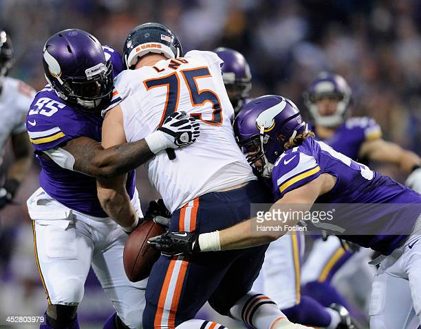 Sharrif Floyd and Audie Cole of the Minnesota Vikings tackle Kyle Long of the Chicago Bears causing a fumble during the fourth quarter of the game on...